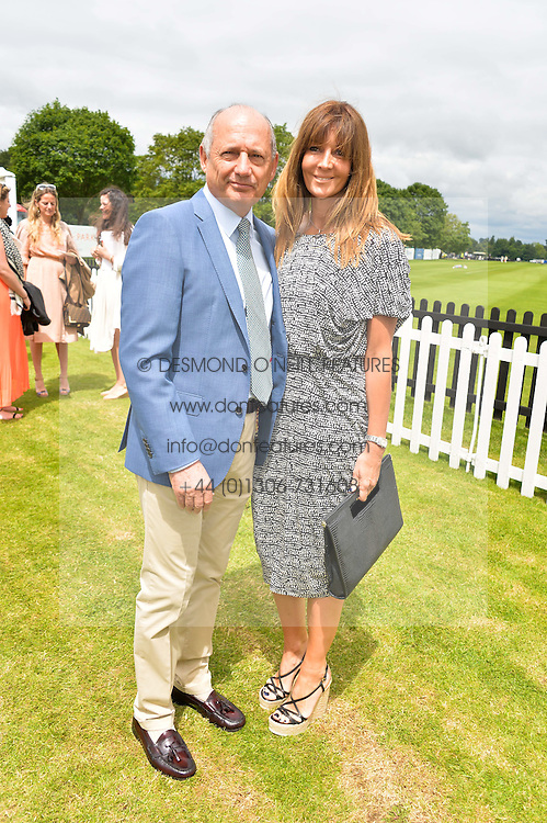 RON DENNIS and CAROL WEATHERALL at the Cartier Queen's Cup Final polo held at Guards Polo Club, Smith's Lawn, Windsor Great Park, Egham, Surrey on 15th June 2014.