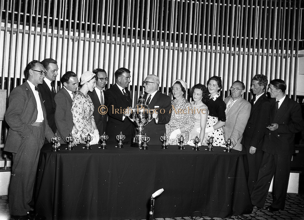 """27/05/1959<br /> 05/27/1959<br /> 27 May 1959<br /> Presentation of Esso Perpetual Trophy to the Listowel Drama Group at the Shelbourne Hotel, Dublin. The trophy and replicas for the  All Ireland Amateur Dram festival were presented by Mr. T.F. Laurie, Chairman and Managing Director of Esso Petroleum Co. (Ireland) Ltd. at a special luncheon. The Listowel group won the competition with their performance of the 3 Act play """"Sive"""" by John B. Keane. Picture shows Mr Laurie (7th from right) presenting the trophy to Mr Bryan McMahon, President Listowel Drama Group. Also in the picture are the cast (l-r): William Kearney; Kevin O'Donovan;  Brian Brennan; Siobhan Cahill; Brendan Carroll (Producer); Bryan McMahon; T.F. Laurie; Mrs D.J. Moloney, Chairman Listowel Drama Group; Margaret Dillon; Nora Relihan; Hilery Neilson; John Flaherty and Sean Cahill."""