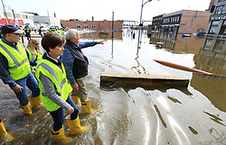 May 3, 2019 - Davenport, Iowa, U.S. - Davenport mayor FRANK KLIPSCH points to the Peterson Paper Co. Apartments as he stops to talk with Iowa Gov. KIM REYNOLDS near the intersection of Pershing Ave. and E 2nd St. in downtown Davenport during a tour of flooded areas of the community Friday. (Credit Image: © Kevin E. Schmidt/Quad-City Times via ZUMA Wire)
