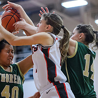 121214       Cable Hoover<br /> <br /> Grants Pirate Caroline Bachman (11) grabs a rebound away from Thoreau Hawks Delrey Begay (40) Friday at Grants High School.
