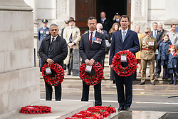 © Licensed to London News Pictures. 25/04/2019. London, UK. Foreign and Commonwealth Secretary Jeremy Hunt (right) lays a wreath at The Cenotaph on Whitehall to mark Anzac Day. Photo credit : Tom Nicholson/LNP