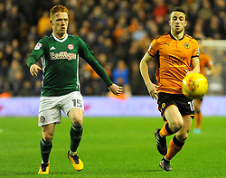 Ryan Woods of Brentford chases down Diogo Jota of Wolverhampton Wanderers -Mandatory by-line: Nizaam Jones/JMP - 02/01/2018 - FOOTBALL - Molineux - Wolverhampton, England- Wolverhampton Wanderers v Brentford -Sky Bet Championship