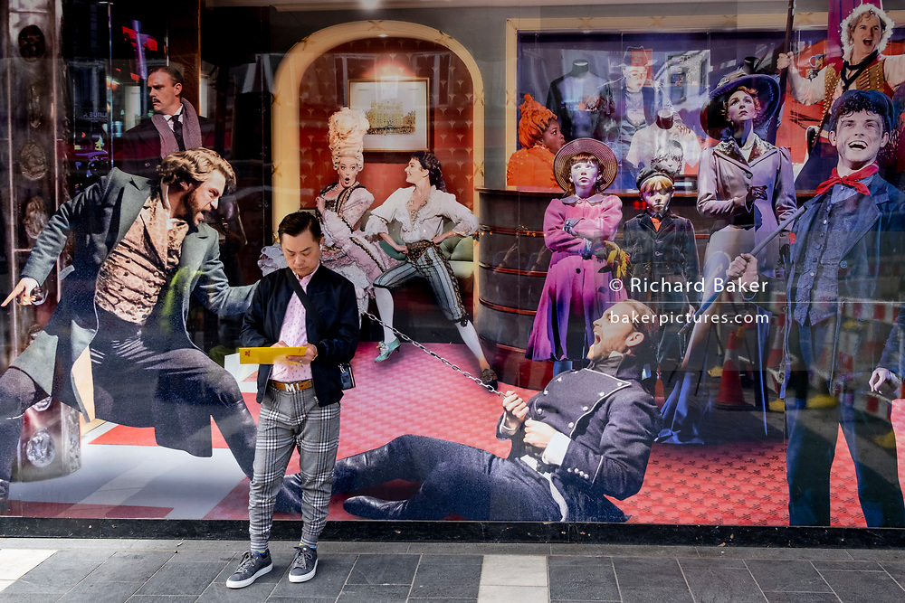 A man stands in front of Cameron Mackintosh's Gieldgud Theatre on Shaftesbury Avenue in London's West End Theatreland, closed for the foreseeable future after repeated Coronavirus pandemic lockdowns, on 27th April 2021, in London, England.