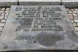 A memorial plaque at the Auschwitz-Birkenau Nazi concentration camps in Auschwitz, Poland on September 3, 2017. Auschwitz concentration camp was a network of German Nazi concentration camps and extermination camps built and operated by the Third Reich in Polish areas annexed by Nazi Germany during WWII. It consisted of Auschwitz I (the original camp), Auschwitz II–Birkenau (a combination concentration/extermination camp), Auschwitz II–Monowitz (a labor camp to staff an IG Farben factory), and 45 satellite camps. In September 1941, Auschwitz II–Birkenau went on to become a major site of the Nazi Final Solution to the Jewish Question. From early 1942 until late 1944, transport trains delivered Jews to the camp's gas chambers from all over German-occupied Europe, where they were killed en masse with the pesticide Zyklon B. An estimated 1.3 million people were sent to the camp, of whom at least 1.1million died. Around 90 percent of those killed were Jewish; approximately 1 in 6 Jews killed in the Holocaust died at the camp. Others deported to Auschwitz included 150,000 Poles, 23,000 Romani and Sinti, 15,000 Soviet prisoners of war, 400 Jehovah's Witnesses, and tens of thousands of others of diverse nationalities, including an unknown number of homosexuals. Many of those not killed in the gas chambers died of starvation, forced labor, infectious diseases, individual executions, and medical experiments. In 1947, Poland founded a museum on the site of Auschwitz I and II, and in 1979, it was named a UNESCO World Heritage Site. Photo by Somer/ABACAPRESS.COM