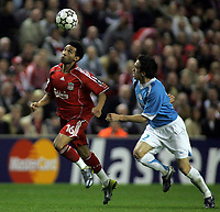 Photo: Paul Thomas.<br /> Liverpool v PSV Eindhoven. UEFA Champions League. Quarter Final, 2nd Leg. 11/04/2007.<br /> <br /> Jermaine Pennant (L) of Liverpool battles Csaba Feher