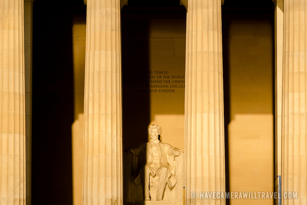 The large statue of the Lincoln Memorial catches the first rays of the sun at sunrise during the equinox in Washington DC. Because the monument faces precisely east, towards the US Capitol Dome, it catches the sun directly only in the days around the equinox.