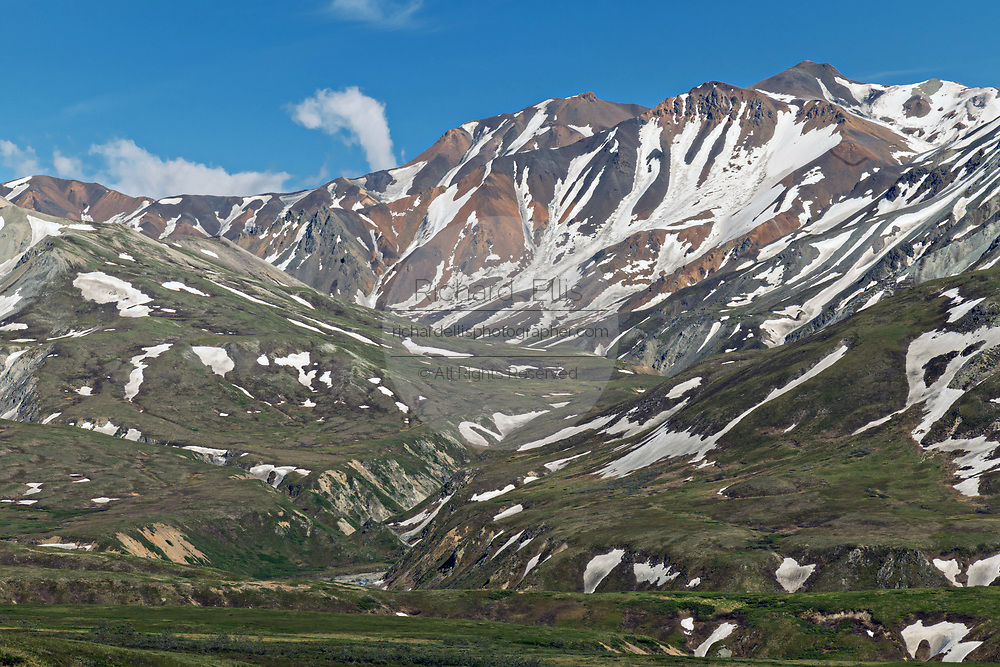 View of the the Alaska Range and the McKinley River across tundra from the Eielson Bluffs in Denali National Park Alaska. Denali National Park and Preserve encompasses 6 million acres of Alaska's interior wilderness.