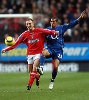 Photo: Javier Garcia/Back Page Images<br />Charlton Athletic v Arsenal, FA Barclays Premiership, The Valley 01/01/2005<br />Dennis Rommedahl is pressed by Gael Clichy