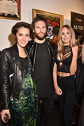 Left to right, Rosanna Falconer, Marc Jacques Burton and Kimberley Garner at a private view of work by Bradley Theodore entitled 'The Second Coming' at the Maddox Gallery, 9 Maddox Street, London England. 19 April 2017.