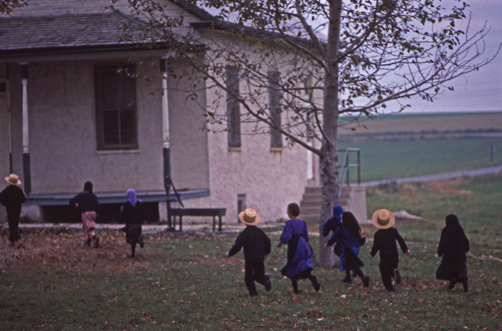 Amish children approaching one room school, Lancaster Co., PA