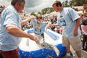 A young competitor is helped out of a pool of instant grits during the grits roll competition at the World Grits Festival April 14, 2012 in St. George, SC. The festival celebrates the southern love for the sticky corn porridge