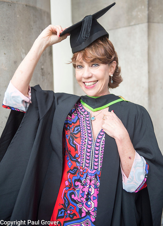 Regent's University London,Graduation Ceremony 2016.Students Graduate from the Psychotherapy,Psychology Drama Film & media Courses.Pic Shows Author Kathy Lette who received an Honorary Senior Fellowship with her son Julius an actor in Holby City who suffers with autism