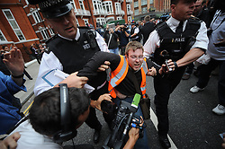 © Licensed to London News Pictures. 16/08/2012. London,UK.Supporters of Julian Assange are arrested in front on the Ecuador embassy today in London    .  Photo credit : Thomas Campean/LNP