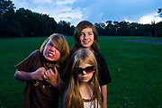 """The Re Family kids """"patiently"""" site for just one more picture during a family Fourth of July party in Lockland, OH."""