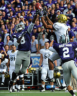 MANHATTAN, KS - OCTOBER 24:  Defensive back Stephen Harrison #8 and safety Tysyn Hartman #2 of the Kansas State Wildcats brake up a pass intended for wide receiver Markques Simas #6 of the Colorado Buffaloes in the second quarter on October 24, 2009 at Bill Snyder Family Stadium in Manhattan, Kansas.  (Photo by Peter G. Aiken/Getty Images) *** Local Caption *** Stephen Harrison; Markques Simas; Tysyn Hartman