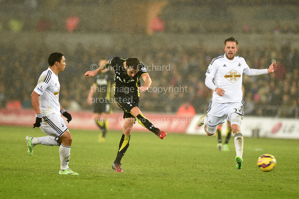 Ryan Mason of Tottenham © has a shot at goal. Barclays Premier League match, Swansea city v Tottenham Hotspur at the Liberty Stadium in Swansea, South Wales on Sunday 14th December 2014<br /> pic by Andrew Orchard, Andrew Orchard sports photography.