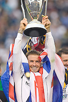 Los Angeles Galaxy midfielder David Beckham (23) holds up the MLS Cup during ceremonies after the 2012 Major League Soccer Championship match between the Houston Dynamo and the Los Angeles Galaxy at the Home Depot Center in Carson, California.  The Galaxy defeated the Dynamo 3-1 to capture their second straight MLS Cup title.