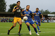 Sean Rigg of AFC Wimbledon, Barry Corr during the Sky Bet League 2 match between AFC Wimbledon and Cambridge United at the Cherry Red Records Stadium, Kingston, England on 18 August 2015. Photo by Stuart Butcher.