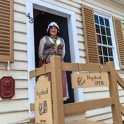 Annapolis, MD, USA - May 20, 2012: A colonial woman in the historic residential area in Annapolis Maryland.