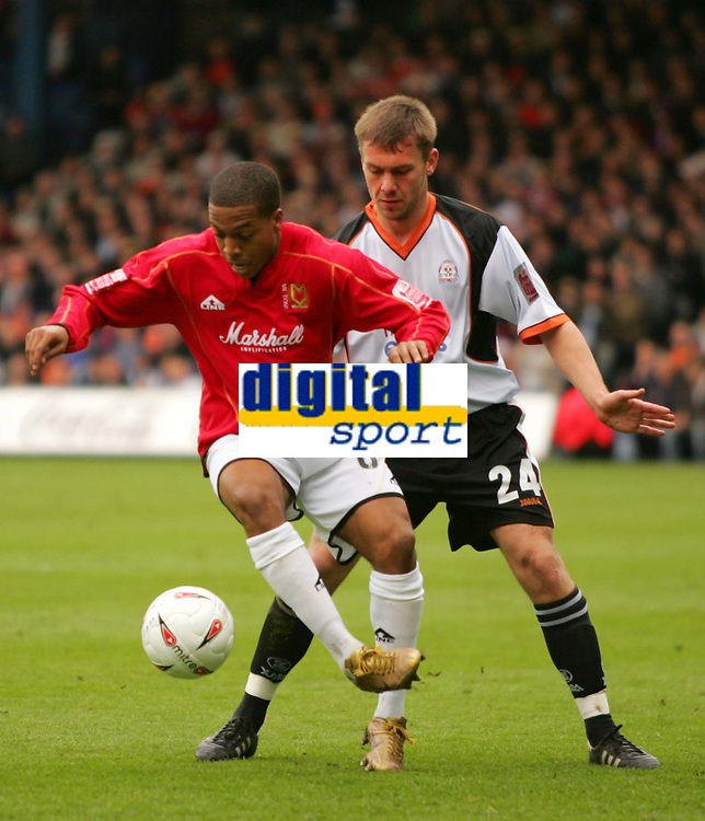 Photo:  Frances Leader.<br /> Luton Town FC v Milton Keynes Dons. The Coca-Cola League One. Kenilworth Road.<br /> 16/04/05<br /> The Dons Wade Small with the ball against Lutons Sol Davis.