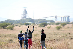 RUSTENBURG SOUTH AFRICA - MAY 18: Protesters return home near the Seraleng mining community on May 18, 2020, in Rustenburg, South Africa. Seraleng residents gathered at Sibanye k5 mine shaft Communities in the area alleged complaints of food parcel corruption by a local ward councillor. Grievances also included concerns with unemployment, loss of business and access to a social labour plan. (Photo by Gallo Images/Dino Lloyd)