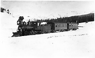 """RGS 2-8-0 #9 on Jackson's special photographic train below Lizard Head Peak viewpoint approaching Gallagher.<br /> RGS  s. of Lizard Head, CO  Taken by Jackson, William Henry - 1/9/1892<br /> In book """"RGS Story, The Vol. IV: Over the Bridges? Ophir Loop to Rico"""" page 333<br /> See RD155-048 for reduction.<br /> Also in """"Mixed Train Daily"""", p. 151; """"Silver San Juan"""", pp. 96-97 and """"Vanishing Varnish"""", p. 237."""