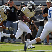 Central Florida quarterback Jeff Godfrey (2) runs during an NCAA football game between the Memphis Tigers and the Central Florida Knights at Bright House Networks Stadium on Saturday, October 29, 2011 in Orlando, Florida. (AP Photo/Alex Menendez)