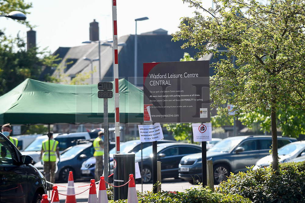 © Licensed to London News Pictures. 26/04/2020. WATFORD, UK. The entrance to a pop-up mobile coronavirus testing centre at Watford Leisure Centre Central.  The testing centre manned by the military is open only for NHS staff and other key essential workers, and is one of mobile testing centres set up by the government to accelerate the testing programme to move towards a target of 100,000 tests per day by 30 April set by Matt Hancock, Health Secretary.  Photo credit: Stephen Chung/LNP