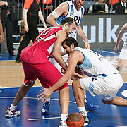 Fenerbahce Ulker's Kaya Peker (R) during their Euroleague Basketball Game 7 match Fenerbahce Ulker between Olympiacos at Sinan Erdem Arena in Istanbul, Turkey, Thursday, December 01, 2011. Photo by TURKPIX