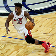ORLANDO, FL - MARCH 14: Jimmy Butler #22 of the Miami Heat drives to the next against the Orlando Magic during the second half at Amway Center on March 14, 2021 in Orlando, Florida. NOTE TO USER: User expressly acknowledges and agrees that, by downloading and or using this photograph, User is consenting to the terms and conditions of the Getty Images License Agreement. (Photo by Alex Menendez/Getty Images)*** Local Caption *** Jimmy Butler
