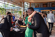 Therron Cunningham Jr. greets Dr. Ellen Smith with a hug as Fairdale High School holds it's prom at the Muhammad Ali Center on Saturday, May 18.