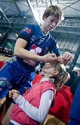 Maryna Vergeliuk with a child after EHF Champions league handball match in Group II between RK Krim Mercator and Gyori Audi Eto KC, on February 7, 2009, in Kodeljevo, Ljubljana, Slovenia. Gyori won 35:31. (Photo by Vid Ponikvar / Sportida)