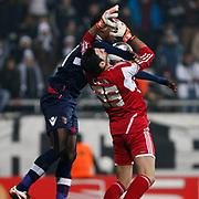 Besiktas's goalkeeper Cenk Gonen (R) during their UEFA Europa League Round of 32 matchday 8 soccer match Besiktas between Braga at Inonu stadium in Istanbul Turkey on Thursday February 23, 2012. Photo by TURKPIX