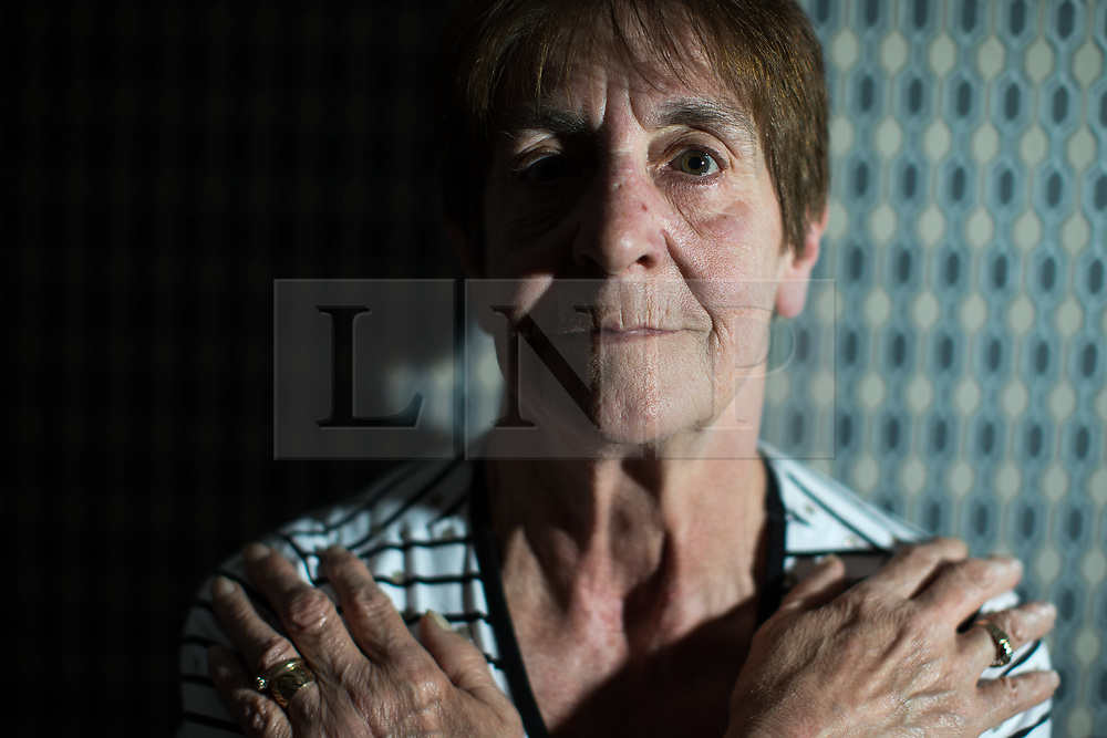 © Licensed to London News Pictures . 06/07/2017 . Manchester , UK . BARBARA DRANSFIELD . Artwork by convicted criminal  Charles Salvador (previously Charles Bronson) has been sold on behalf of Salvador to raise a £1,000 to support Barbara and Len Dransfield . Barbara , who has become friendly with Salvador , was brought the money and a card by Salvador's fiance , Paula Wiliamson . Barbara Dransfield was brutally assaulted by masked robbers as she sat at home in her wheelchair . She suffered extensive injuries to her face and body . Photo credit : Joel Goodman/LNP