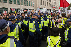 A large group of Metropolitan Police officers moves towards thousands of students attending the National Demonstration for a Free Education on 4th November 2015 in London, United Kingdom. The demonstration was organised by the National Campaign Against Fees and Cuts (NCAFC) in protest against tuition fees and the Government's plans to axe maintenance grants from 2016.