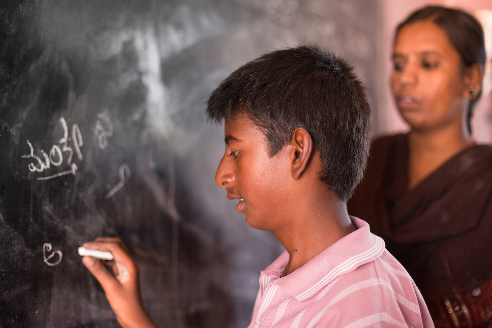 CAPTION: Mantesh, who has a learning disability, hardly communicates with other children or even with his parents. His family is keen for him to get involved in the local Chamkol programme-supported After School Club (ASC), but feels the challenge lies in getting him to attend and participate. His case worker will therefore be working with him according to his Individual Education Plan (IEP) to help him develop his self-belief, and also with his mother, who needs encouragement to believe in him. LOCATION: Mallianpura (village), Kasaba (hobli), Chamrajnagar (district), Karnataka (state), India. INDIVIDUAL(S) PHOTOGRAPHED: Mantesh (left) and Vathsalakumari (right).