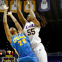 December 13, 2011; Baton Rouge, LA; LSU Lady Tigers forward LaSondra Barrett (55) shoots over UCLA Bruins guard/forward Rhema Gardner (20)during the first half of a game at the Pete Maravich Assembly Center.  Mandatory Credit: Derick E. Hingle-US PRESSWIRE