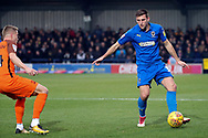 AFC Wimbledon defender Ben Purrington (3) passing ball down the line during the EFL Sky Bet League 1 match between AFC Wimbledon and Southend United at the Cherry Red Records Stadium, Kingston, England on 24 November 2018.
