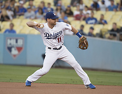 August 11, 2017 - Los Angeles, California, U.S - 11 Aug 2017. The Los Angeles Dodgers play the San Diego Padres in the first  game of a three-game series at Dodger Stadium. Pictured is Dodger 2nd baseman Logan Forsythe throwing to first base. (Credit Image: © Prensa Internacional via ZUMA Wire)
