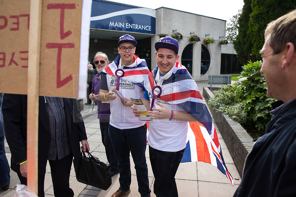 © Licensed to London News Pictures . 29/09/2017 . Torquay , UK . UKIP supporters wearing Union Jack flag capes meet protesters against the UKIP conference , outside the venue . The UK Independence Party Conference at the Riviera International Centre . UKIP is due to announce the winner of a leadership election which has the potential to split the party . Photo credit: Joel Goodman/LNP