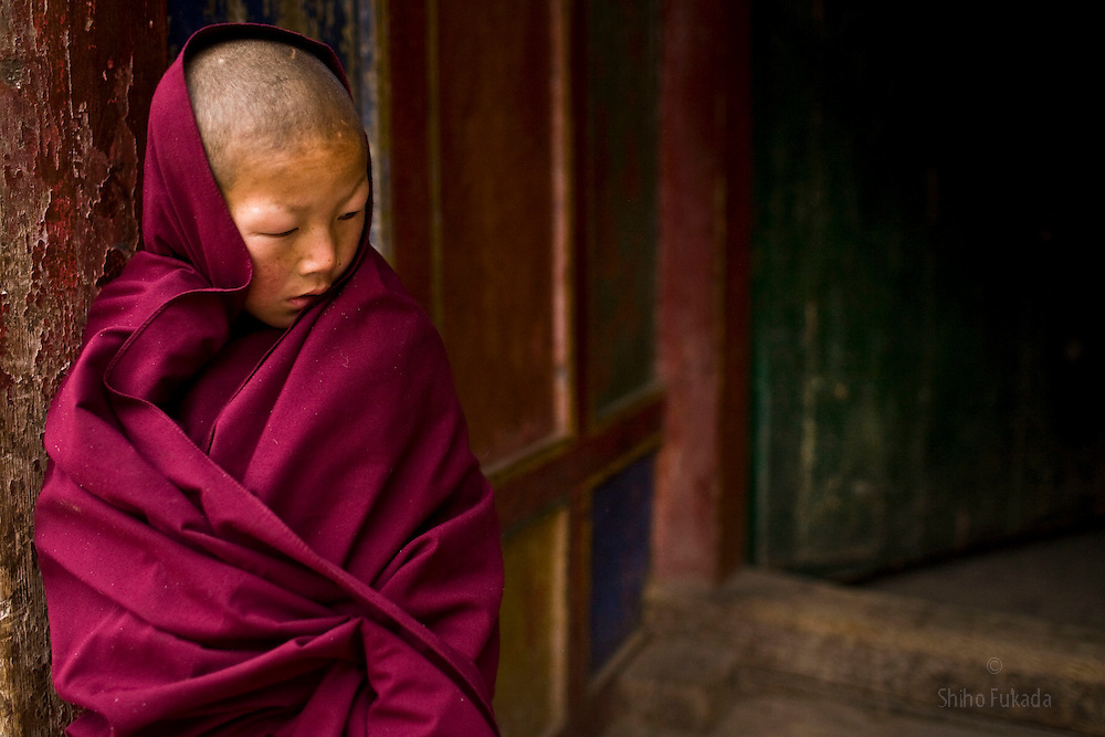 Tibet New Year - China - Edward Wong<br /> A child monk stands at doorway after morning prayer at Rongwo monastery  (Longwu in Chinese) on Tibetan New Year's Day in Rebkong (Tongren in Chinese), Qinghai province in China, February 25, 2009. Photo by Shiho Fukada for The New York Times