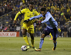 October 31, 2017 - Columbus, OH, USA - Columbus Crew forward Ola Kamara, left, fights for the ball with New York City FC defender Alexander Callens during the first half of an MLS Eastern Conference Semifinal playoff game against the New York City FC in Columbus, Ohio, on Tuesday, Oct. 31, 2017. (Credit Image: © Adam Cairns/TNS via ZUMA Wire)