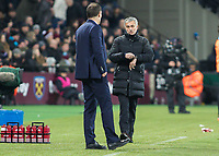 Football - 2016 / 2017 Premier League - West Ham United vs. Manchester United<br /> <br /> Manchester United Manager Jose Mourinho shows West Ham Manager Slaven Bilic that the referee has a watch that tells him if the ball has crossed the goal line at The London Stadium.<br /> <br /> COLORSPORT/DANIEL BEARHAM