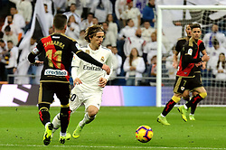 MADRID, Dec. 16, 2018  Real Madrid's Luka Modric (L) dribbles during a Spanish league match between Real Madrid and Rayo Vallecano in Madrid, Spain, on December 15, 2018. Real Madrid won 1-0. (Credit Image: © Edward F. Peters/Xinhua via ZUMA Wire)