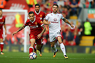 Philippe Coutinho of Liverpool and Robbie Brady of Burnley chase for the ball. Premier League match, Liverpool v Burnley at the Anfield stadium in Liverpool, Merseyside on Saturday 16th September 2017.<br /> pic by Chris Stading, Andrew Orchard sports photography.