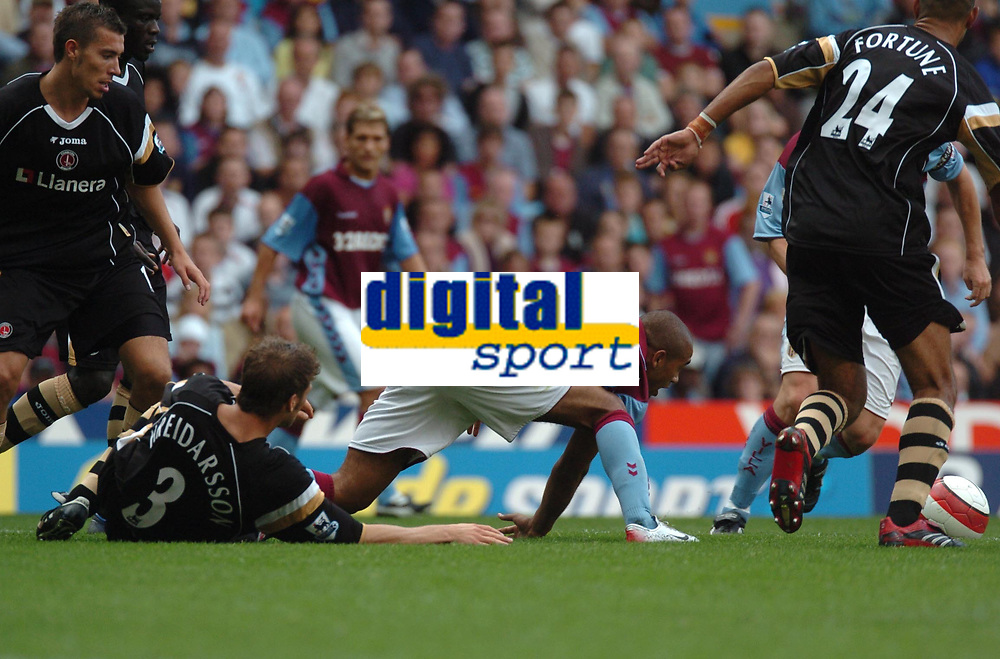 Photo: Ian Hebden.<br />Aston Villa v Charlton Athletic. The Barclays Premiership. 23/09/2006.<br />Villa's Luke Moore (C) stretches for the ball while Charlton's Herman Hreidarsson (L) tries to intercept.