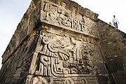 Tourists stand at the top of the Temple of the Plumed Serpent (Quetzalcoatl) at Xochicalco, a fortressed commercial and religious Olmec center in Morelos state, Mexico.