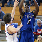 Trask's Rasheed Brown shoots over Alamance's Wyatt Howard during the championship game of the Trask Holiday Tournament. (Jason A. Frizzelle)
