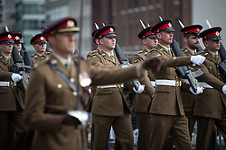 © Licensed to London News Pictures . 01/07/2016 . Manchester , UK . Soldiers parade to Manchester Cathedral . Somme100 events in Manchester City Centre to commemorate the 100th anniversary of the first day of the Battle of the Somme . Photo credit : Joel Goodman/LNP