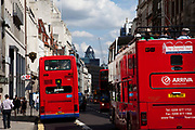 Red London buses and tour buses on Fleet Street, central London
